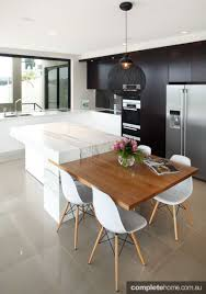 Integrating A Table Into Your Breakfast Bar Saves Room And Is - Dining table in kitchen