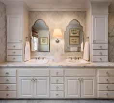 bathrooms with white cabinets with traditional bathroom lighting