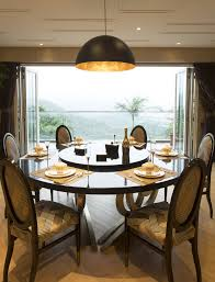 family swap hong kong island for tai po home with rich feng shui dining room the pendant light hk 6 000 was from john lewis www johnlewis com in london britain the dining table with lazy susan hk 100 000 and