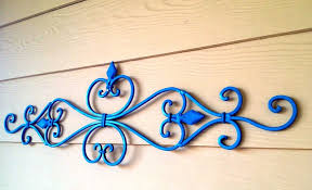 wall design ideas brown wooden wrought iron scroll wall