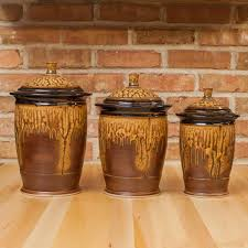 three canister set in brown ash black glaze royce yoder