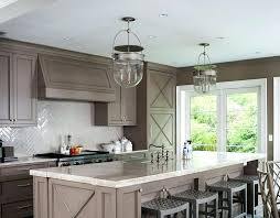 taupe kitchen cabinets with black countertops uk white appliances