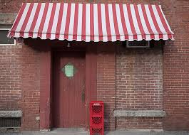 White Awning Red And White Striped Awning And Milk Crates