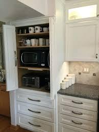 cabinet for kitchen appliances appliance cabinets kitchens kitchens with black appliances sink