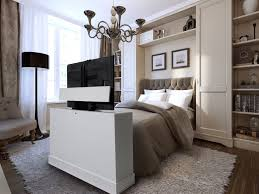 tv lift cabinet foot of bed azura 360 degree swivel in white finish tv lift cabinet sitting