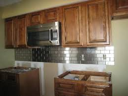 kitchens with stainless steel backsplash stainless steel backsplash with oak cabinets oak cabinet best wall