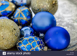 blue and gold christmas decorations on a silver tray stock photo