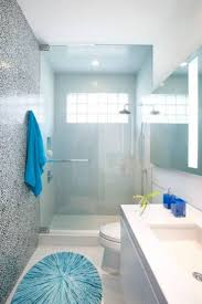 best images about bathroom design pinterest traditional small bathroom designs with walk shower glass door and blue mat towes narrow layout best design ideas