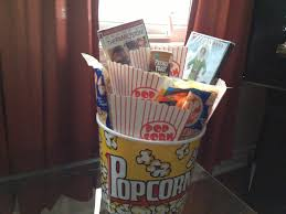 christmas movie themed gift basket a bucket of popcorn filled
