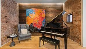 Home Legend Piano Finish Laminate Flooring Look Around John Legend And Chrissy Teigen U0027s 4 Million Condo Bossip