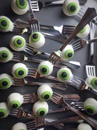 eyeball cake pops on silver forks so fun for halloween