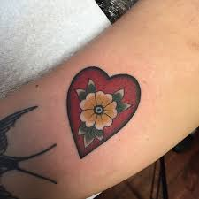 nice yellow flower in red heart tattoo golfian com