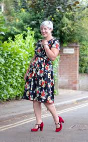 post bold summer floral tea dress and red shoes