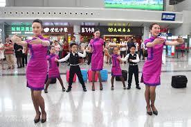 airline cabin crew photos junior cabin crew flash mob surprises travelers at ctu