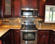 Kitchen Granite And Backsplash Ideas by Medium Brown Cabinets With White Quartz Countertop Google Search