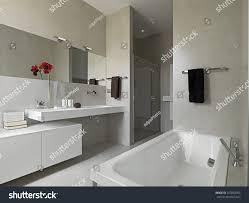 modern bathroom masonry shower cubicle bathtub stock photo