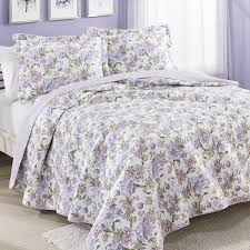 with a beautiful floral pattern on one side this lovely quilt is