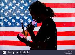 Use Flag Man Smoking Bong With American Marijuana Flag In Background Stock
