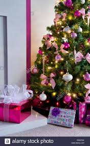 close up of christmas tree decorated in pink and white theme stock