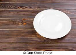plate table top empty white plate on wooden table top view empty white stock