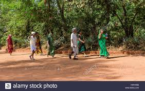 indians walking to the matrimandir at auroville an experimental