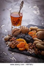 traditional arabic tea and fruits and nuts selective focus