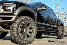 Ford Raptor Black - ford raptor with 22in black rhino warlord wheels exclusively from