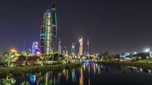 music fountains in park with kuwait city cityscape night timelapse
