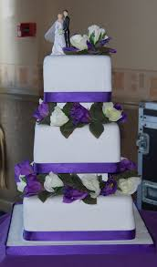 hours of fun cadbury purple 3 tier wedding cake simple and elegant