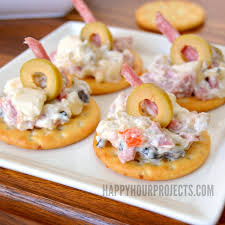canape orleans orleans flavors muffuletta dip and cajun bloody