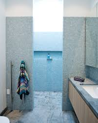 bathroom wall with pink blue green and purple glass mosaic tiles