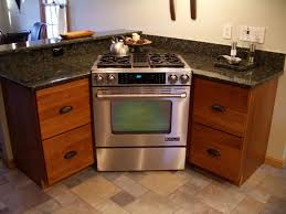 Cherry Kitchen Cabinets With Granite Countertops Cherry Cabinets Kitchen Cabinets Stainless Steel Range Stove