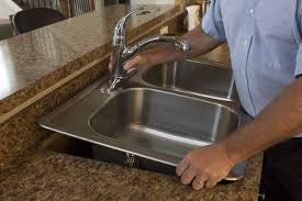 remove old kitchen faucet how to replace a drop in kitchen sink sinkology