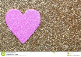 pink heart over gold glitter background valentines day card stock