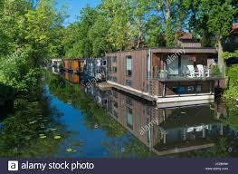 floating houses floating houses in a canal in utrecht netherlands stock photo