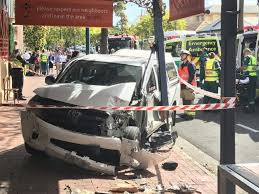 car crashes into front veranda of lion hotel at north adelaide