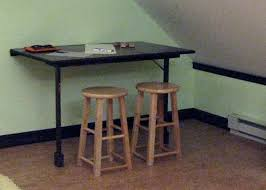 Wall Mounted Collapsible Desk Build A Foldout Desk And Craft Table Hgtv With Regard To Fold Away