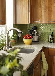 green kitchen tiles backsplash with wooden cabinets and quartz