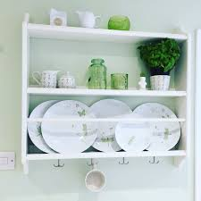 stenstorp ikea plate rack in a green and white kitchen shelfie