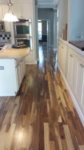 acacia wood flooring with golden look home decor