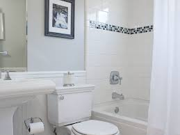 bathroom double sink small bench white flowers white vanity white