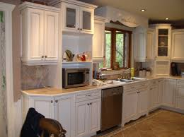 Refinishing Kitchen Cabinets Before And After Cabinet Reface A Budget Kitchen Remodel With Cabinet Refacing And