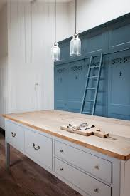kitchen of the week the plain english power in numbers kitchen numbered blue kitchen cabinets and a roilling ladder in a dorset farmhouse kitchen by plain english