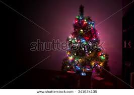 snow covered christmas tree multi colored stock photo 210794914