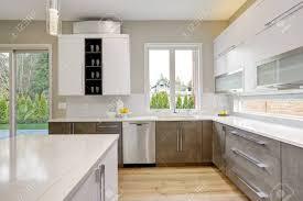 brown and white kitchen cabinets luxury kitchen with white quartz backsplash