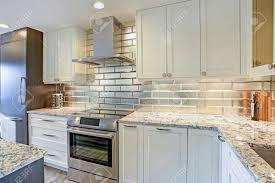 white shaker kitchen cabinets backsplash modern white kitchen design with silver backsplash white shaker
