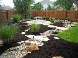 water feature disappearing into a dry creek bed with a large