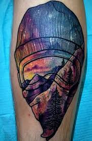 cool watercolor mountain tattoo on leg