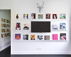 great ideas for 3 d wall art that aren t antlers hgtv s pop art gallery wall with tv and faux deer head
