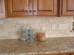 kitchen tile backsplash pictures here s a simple beige colored kitchen backsplash with a granite